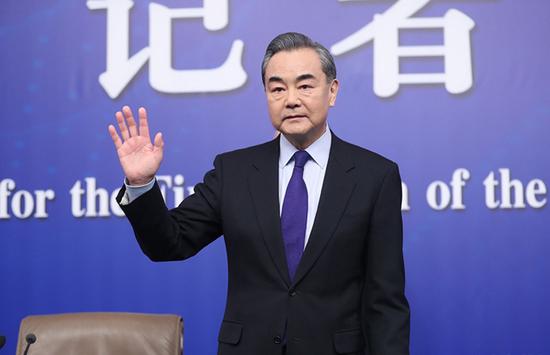 王毅谈中美关系:可有竞争不必做对手 更需当伙伴