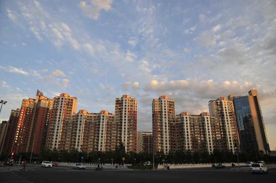 北京东三环附近的楼宇。视觉中国 资料图