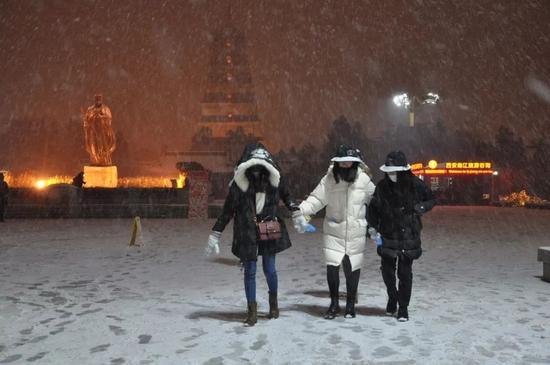 △1月3日,古城西安迎2018年首场大雪。