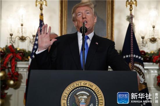↑12月6日,美国总统特朗普在华盛顿白宫发表讲话。新华社/美联