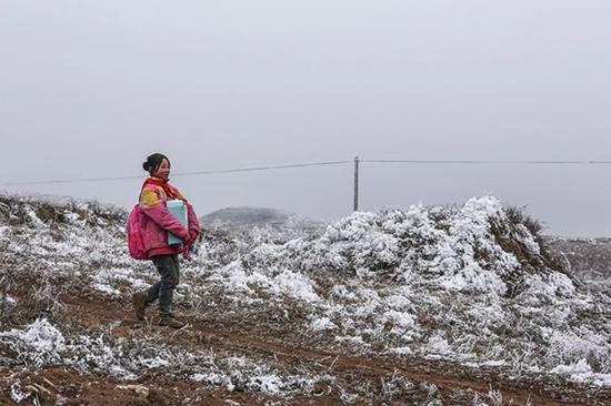 张兴珍所在的梨柴林社是离学校最远的。