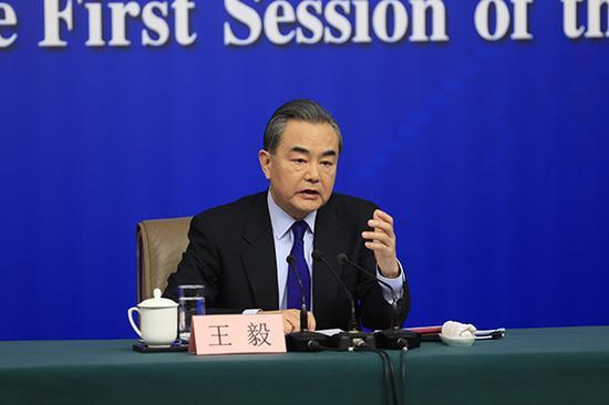 外交部部长王毅出席新闻发布会。 澎湃新闻记者 赵昀 图