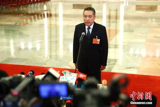 国家工商行政管理总局局长张茅。 中新社记者 富田 摄