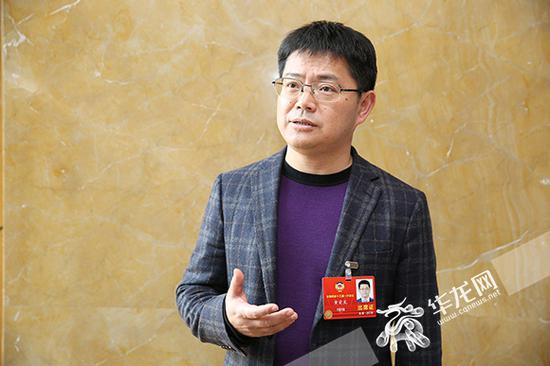 全国政协委员黄爱龙。 特派记者 刘嵩 摄