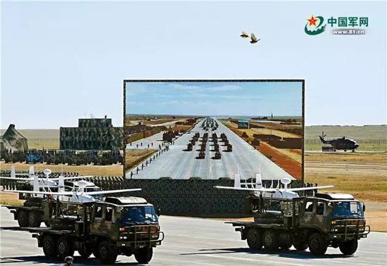 无人机方队受阅机群由通信干扰无人机、雷达干扰无人机和反辐射无人机组成,能够对敌方指挥通信体系进行有效压制。范显海 摄