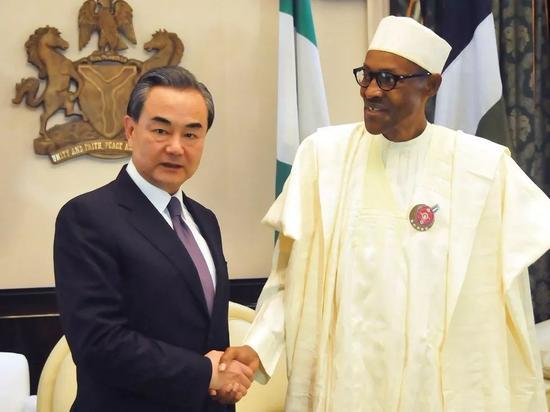 尼日利亚总统布哈里在阿布贾总统府会见中国外交部长王毅