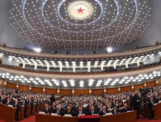 3月13日,十三届全国人大一次会议在北京人民大会堂举行第四次全体会议。新华社 图