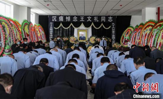 图为王文礼的追悼会现场。家人供图
