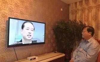 赛罕区残联组织党员干部收看专题记录片