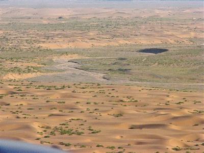 飞播区治沙前情景。(资料图)