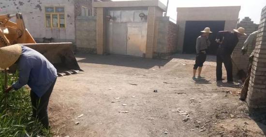 清理村庄巷道、村民房前屋后垃圾