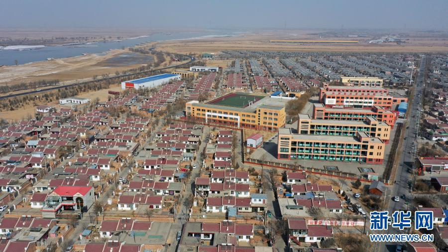 宁夏银川市兴庆区月牙湖乡滨河家园移民村(无人机照片,2021年2月11日摄)。