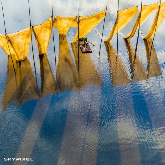 2016年天空之城摄影大赛 年度大奖 《渔夫收线》 作者:郑戈