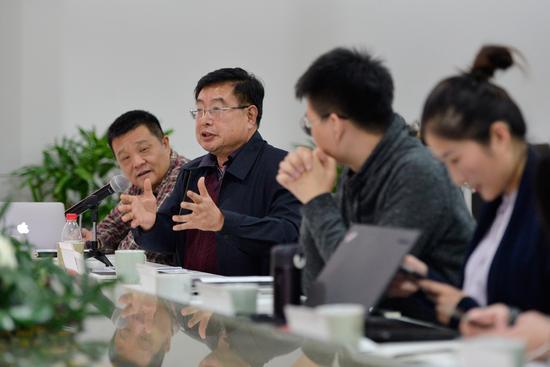 中国海关摄影协会主席张志南就摄影共享经济阐述自己的想法。 周星宜 摄