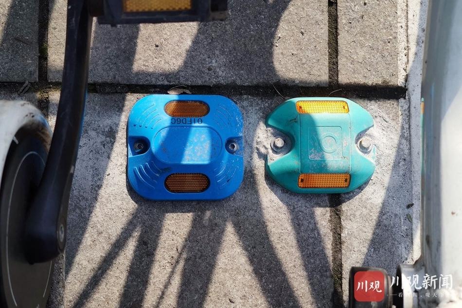 """成都首批""""蓝牙道钉""""上岗 共享单车停放有了好规范"""