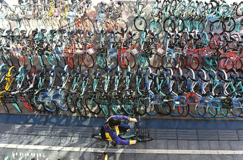 从解决痛点到成为城市痛点 无处安放的共享单车