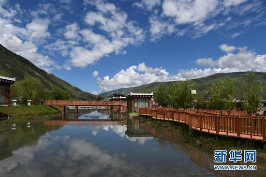 沟尔普村一景(8月2日摄)。新华社记者 卢宥伊 摄