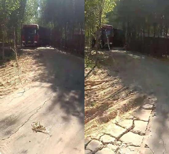 十里坞村村道路面,图中红色货车为货车司机赵某驾驶车辆。图片来源:受访者赵某
