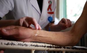 我国存活艾滋病感染者约125万 新发感染者每年8万例左右