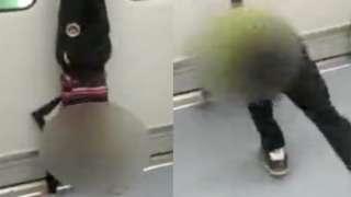 """男孩倚靠地铁门练倒立 """"虎妈"""":不到站不准停"""