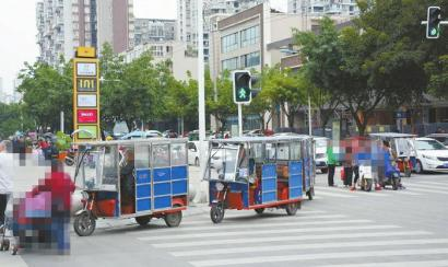 成都龙泉驿区重拳整治交通秩序 三轮车没了城市变美了