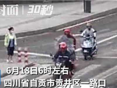 视频丨两轮摩托车摔倒 头盔保护司机头部仅受擦伤