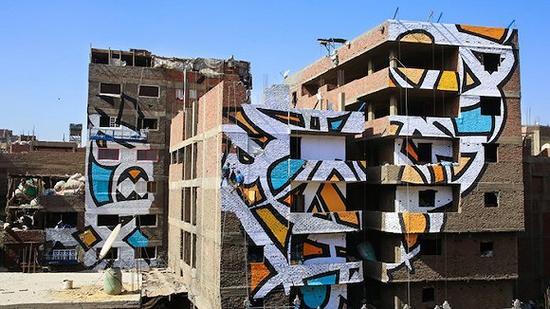 以城市为画布,他跨越50栋建筑画了这幅涂鸦