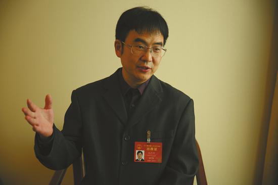 全国人大代表、雅安市人民医院副院长张德明。