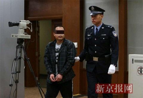 37岁的张国利在二中院受审。新京报记者 王贵彬 摄