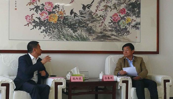 佘春明会见水木动画董事长施向东
