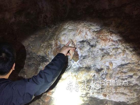 6日中午,沂水县物价局工作人员和警方再次来到钟乳石破坏现场取证。
