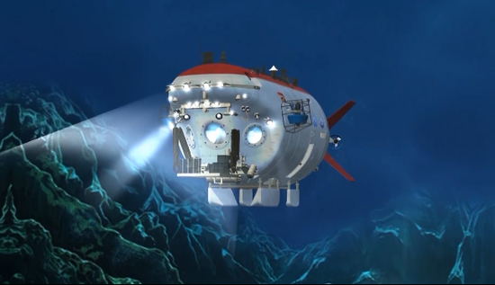 """再往下走,在水下7000米的地方就可以见到我国自主研发的""""蛟龙号"""",这是目前世界上下潜最深的作业型载人潜水器。"""