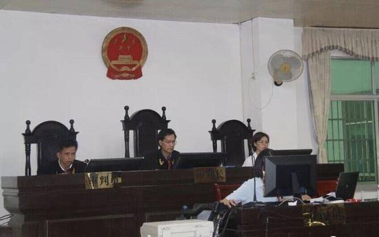 庭审现场。河池市中级人民法院供图