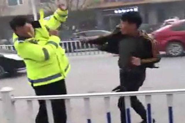 济南一男子带孩子闯红灯被拦后殴打交警 被提请逮捕