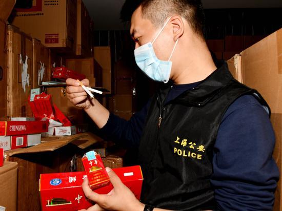跨国假烟犯罪团伙归案:涉案超4亿 查获成品烟上百万条