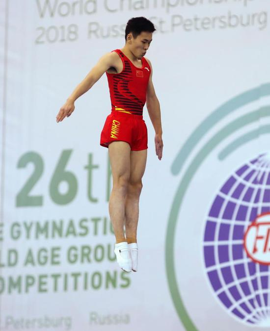 图说:儿子高磊在俄罗斯喜获金牌。