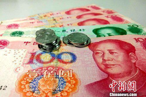 图说:人民币。中新网记者 李金磊 摄
