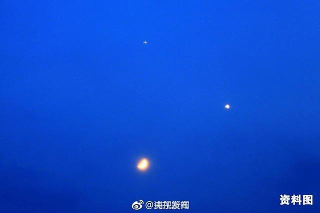 申城水逆加阴雨 市民无缘观赏双星伴月