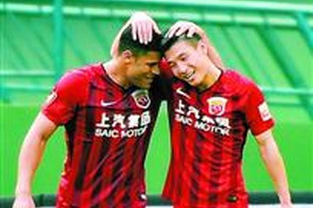 上港逆转领跑中超积分榜 武磊成中超第四个大四喜球员