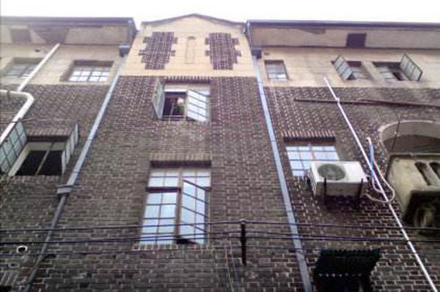 历史建筑国泰公寓外违建引效仿 街道改造不拆反搭高重建