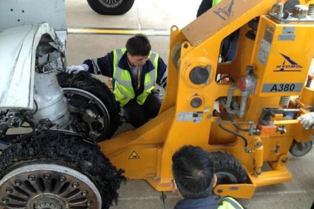 马航上海飞吉隆坡客机中断起飞航班取消 因起落架爆胎