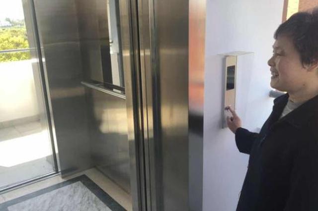 金山创新老房加装电梯模式 顶楼居民出资15万仍说值