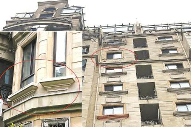 杨浦雍景苑小区外墙30%空鼓 房顶40千克重旗杆往下掉