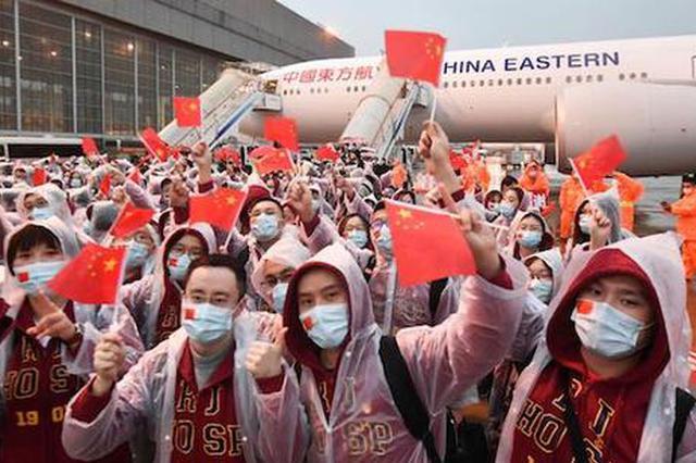 上海援鄂医疗队700多名队员返沪 寒冬中出征春意中凯旋