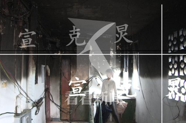 上海静安某民宅起火殃及邻居 男主人被带走接受调查