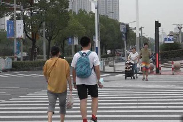 行人闯红灯当场予以处罚 上海将取消累进式执法模式