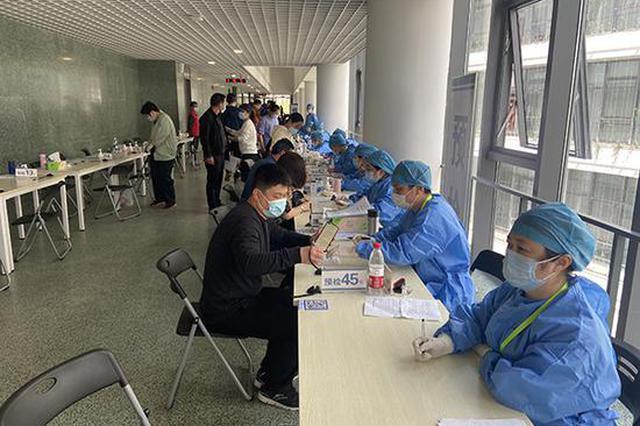 直击上海青浦新冠疫苗接种点:单人现场耗时1-1.5小时