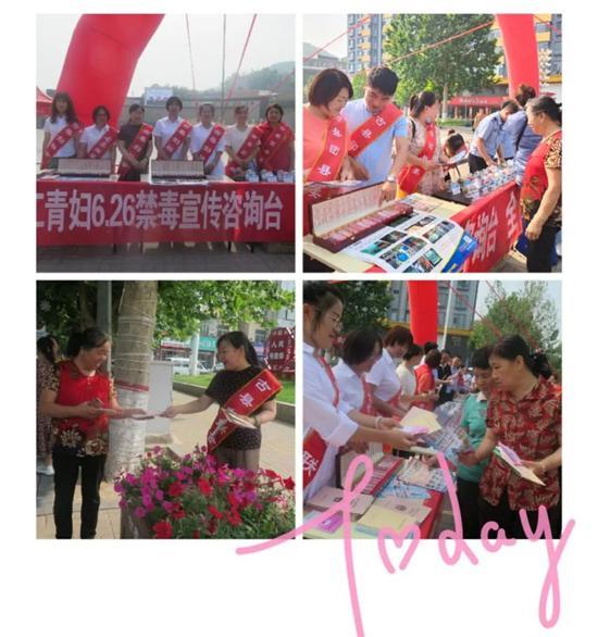 工青妇工作人员向周围群众发放宣传资料