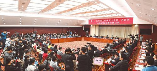 3月9日,出席十三届全国人大一次会议的山西代表团举行全体会议,对中外媒体开放。图为会议会场。本报记者李联军摄