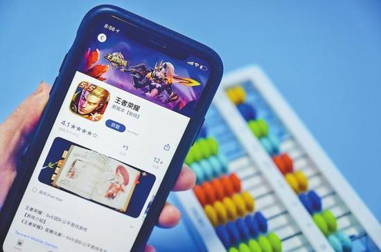 手机游戏《王者荣耀》界面。CFP